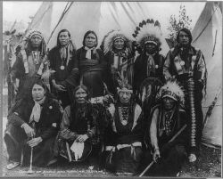 Ten Apache and Sioux chiefs, three in headdresses, wearing native clothing, at the St. Louis Exposition, 1904. Source: Library of Congress.